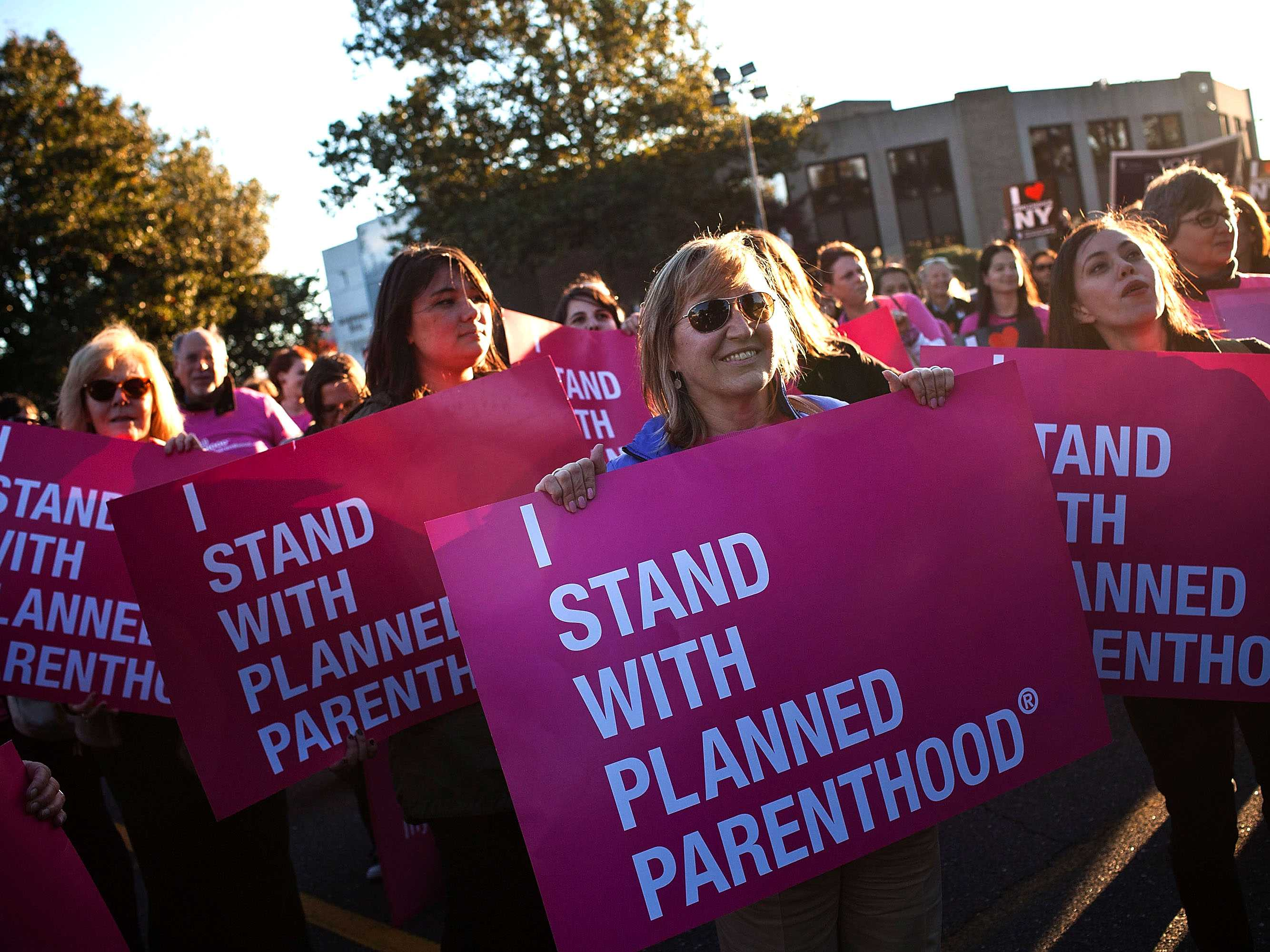 HEMPSTEAD, NY - OCTOBER 16:  Women protest for continued funding of Planned Parenthood outside Hofstra University prior to the second presidential debate on October 16, 2012 in Hempstead, New York. U.S. President Barack Obama and Republican presidential candidate Mitt Romney will debate in a town hall style meeting this evening at the university.  (Photo by Andrew Burton/Getty Images)