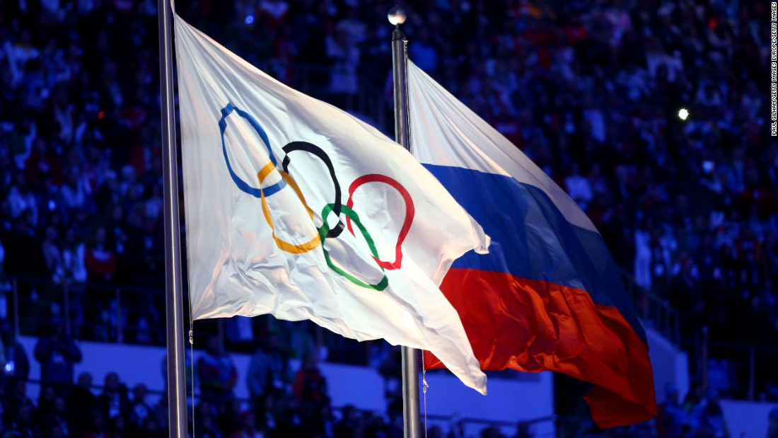 Above: Olympic and Russian flags side by side. Athletes will not be permitted to represent Russia in the upcoming Winter Games in February.