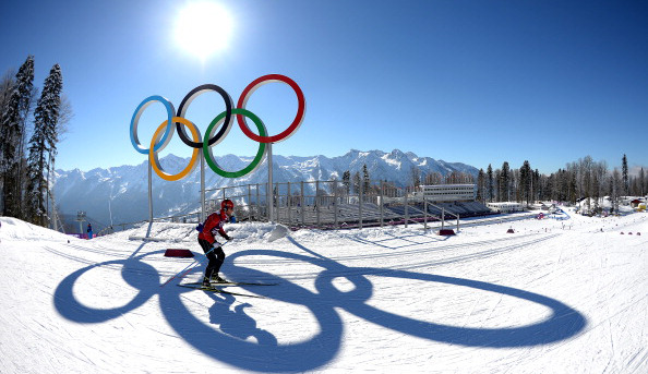 Olympic rings overlook as the skiing competition takes place at the Winter Games.
