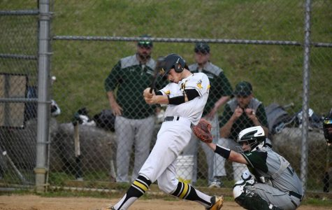 Brandon Licursi taking a big swing against Kinnelon. Photo courtesy: Kristen Milko