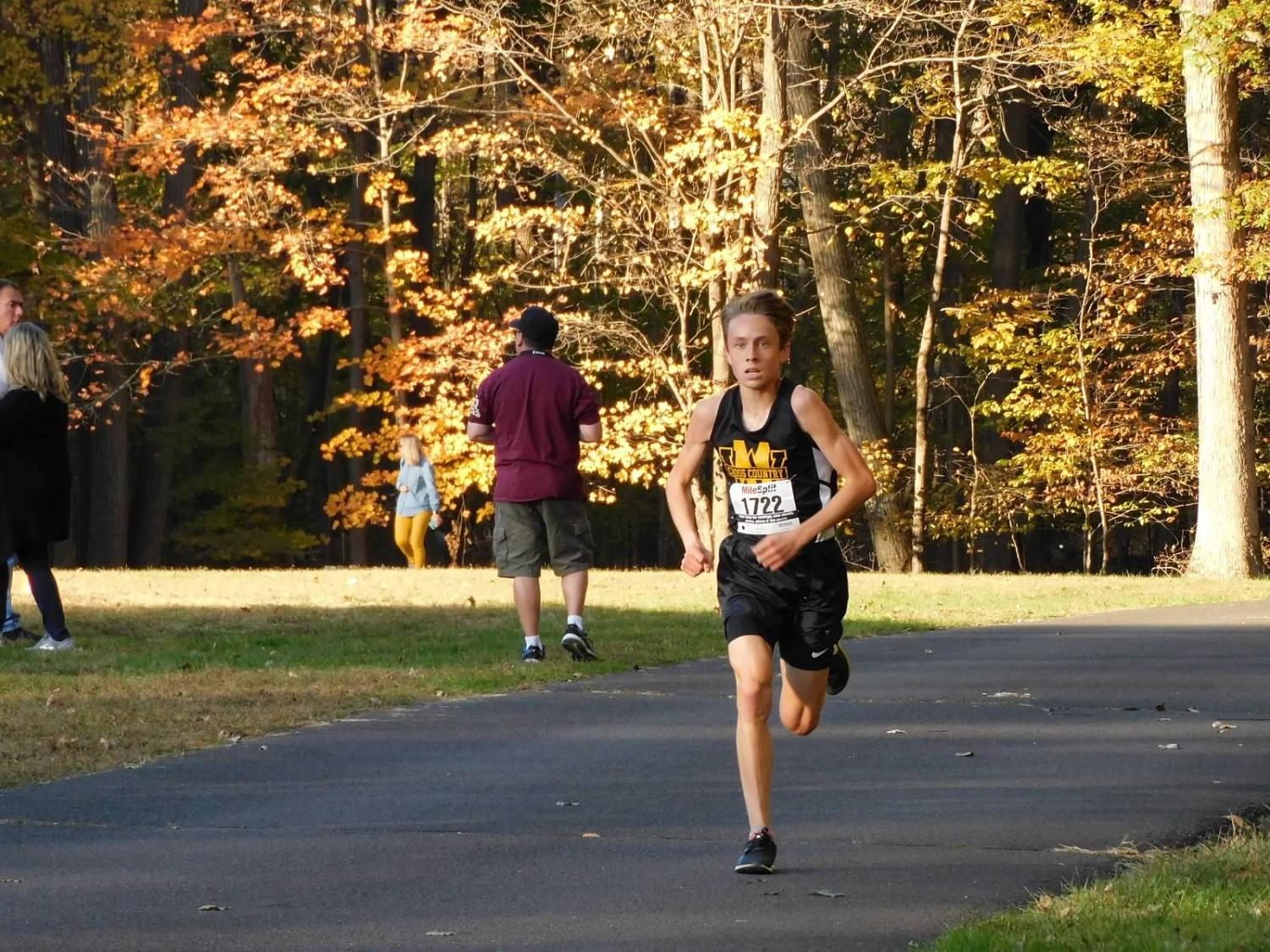 Collin Clinton crosses the finish line to get first overall at Conference Championships.  Photo Courtesy: Julie Bramley.