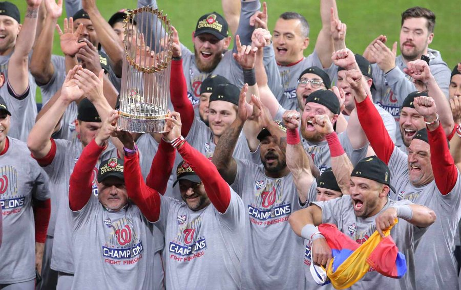 Washington+raises+the+trophy+as+they+celebrate+its+first+title.+%0APhoto+Courtesy%3A+thenation.com